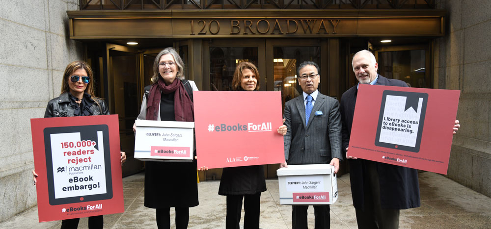Left to right: Immediate Past President Loida Garcia Febo, Public Library Association Executive Director Barb Macikas, Past President Sari Feldman, Senior Director, Public Policy & Government Relations Alan Inouye, deliver petitions to MacMillan Publishers Headquarters in New York City.